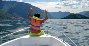 Boy on motorboat on Lake Como
