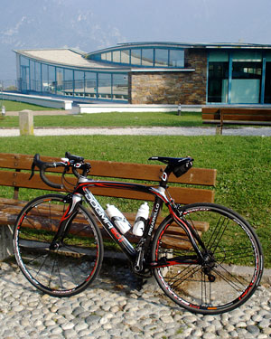 A Pinarello Dogma, the pinnacle of road bike technology, with the Museo del Ciclismo in the background.