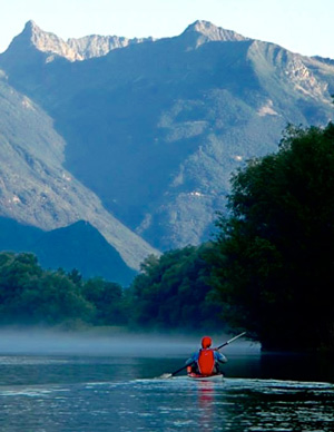 Photo of kayaker with majestic mountain in the background