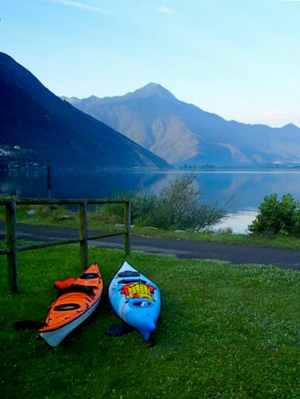 Photo of two Kayaks on the shore of Lake Como