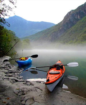 Photo of Kayaks on shore of Lake Como all geared up and ready to go.
